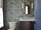 Powder bath with Cole and Sons wallpaper.