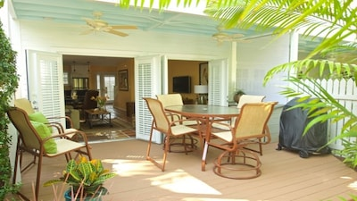 Back deck and tropical garden.  A perfect spot to relax with a cup of coffee.