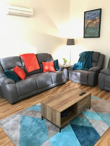 Recliner chairs and very comfortable couch, lots of rugs & heating for warmth.