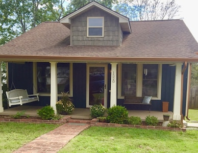 Wide front porch with covered seating