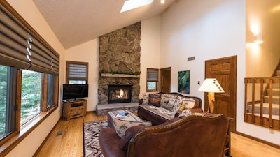 Living Room with Large Windows and Gas Fireplace