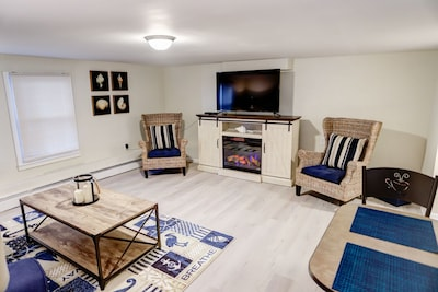 Living Room with Fireplace/Heater which changes color according to your Mood.