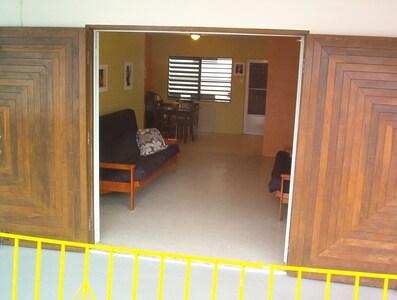 Entrance to Casa Mango from the balcony. Massive mahogany doors are beautiful.