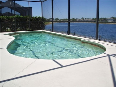 Beautiful views of the natural lake from our pool deck