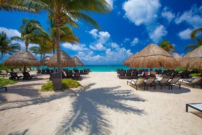 Private Beach Club with full bar, volleyball net, hammocks & plenty of seating