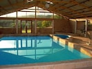 Indoor pool house, with jacuzzi, massage table, weights, pool table, ping pong.