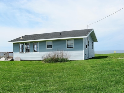 Ocean Front Cottage with beautiful private beach and the lake of shining waters