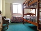 Second bedroom with walk in closet..  Now has two bunk beds.