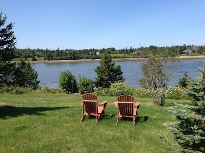 View from the Adirondack chairs to the cove, out to Placentia and Swan's Islands