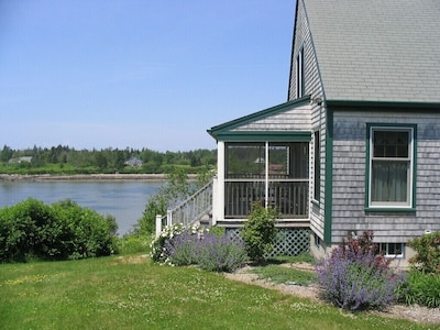 View of screened porch; islands and open ocean to the left for best porch view.
