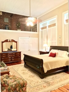 King Master Bedroom w/ Sitting Area & Bath. 16 foot ceilings. Grand Architecture