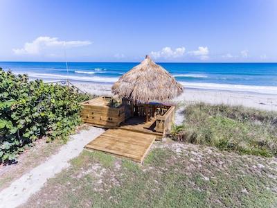 Private tiki bar overlooks the beach