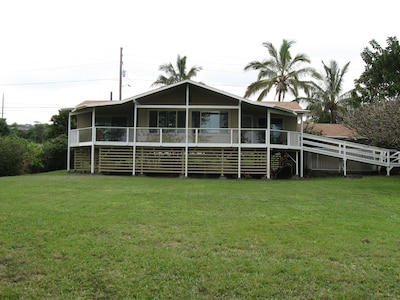 View of house from golf course. Note the wheel chair ramp and wraparound lanai.