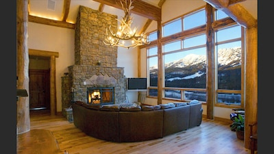 cozy fire and view of Bridger Bowl from great room at Bridger Vista Lodge