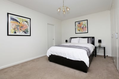 Large bedroom with queen bed and lots of wardrobe space