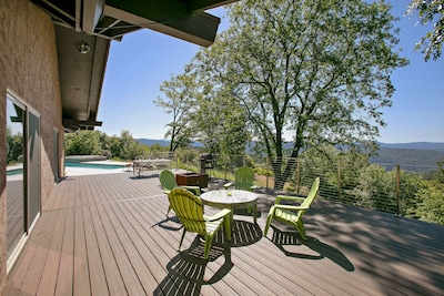 New deck with a fire pit and dining areas
