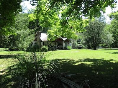 Historic 100-year old log cabin on farm