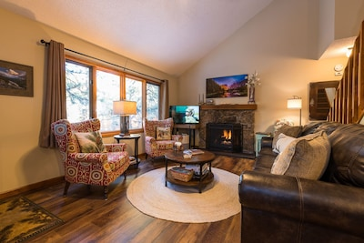 Large windows facing the river just 50 feet away! Gas fireplace, new Smart TV