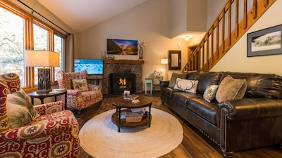 Living Room - filled with local art, wonderful views of river, gas fireplace