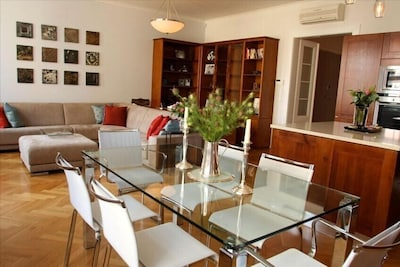 High-end Italian fixtures and custom furnishings throughout the apartment