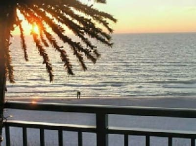 View from the balcony at and living room at  sunset