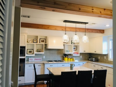Large kitchen with eating island.