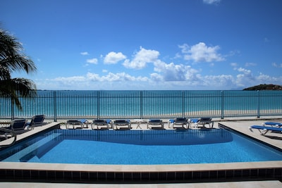 A great view of beautiful white sandy beach and aqua marine ocean!