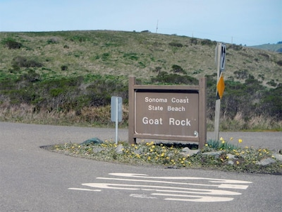 Look for this state beach park sign and enter to reach property inside.