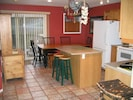 Fully-equipped kitchen and dining area.