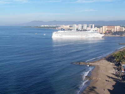 From the balcony, you can wave to the cruise ships  as they sail into port.