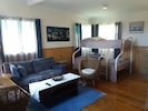 The spacious family area is comfortably furnished,  with free WiFi and Netflix