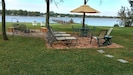Patio & fire pit are fun for entertaining. Don't forget relaxing on the hammock.