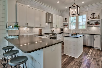 kitchen fit for a gourmet, wide and open to the living and dining areas