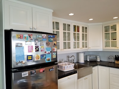Modern kitchen with stainless appliances.