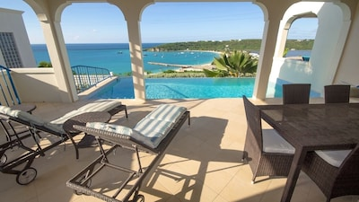Spacious pool deck, infinity pool and the view!