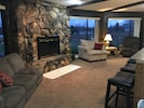 Lower seating area and fieldstone fireplace