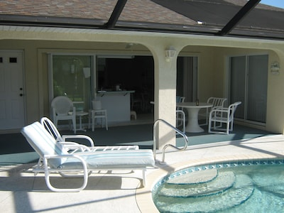 Great pool area with lanai and grilling area