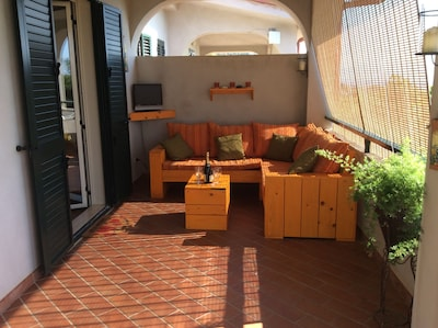 Out side seating area with sun blinds