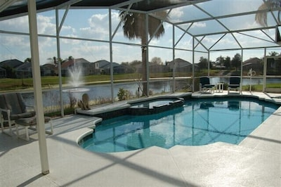 Lake and south facing pool view with fountain. Covered Roof on the left side
