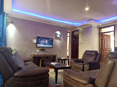 Living Room with a Samsung Flat Screen HD Smart TV