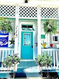 Bright sunny front porch. Bistro set