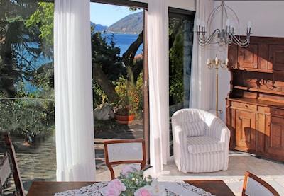 """Barony """"giardino"""" vicino al lago di Castagnola, piscina, aria condizionata, parco, vista lago, vista lago k"""