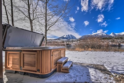 Enjoy stunning mountain views from a private hot tub at this Silverthorne home!