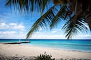 From Your Door Step to the white sand beach. Take beach chairs, towels, umbellas