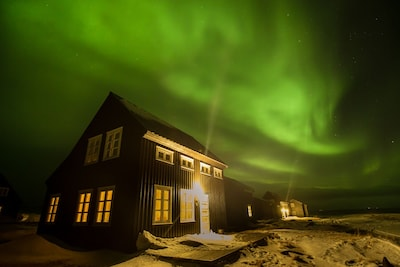 Our house and aurora, photo by one of our regular guest  (his 4th visit)