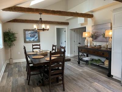 Large formal dining area with seating for 6-8 people
