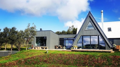 Eirð is designed to combine the in- & outside experience w south facing windows
