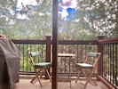 Balcony with bistro set, large gas BBQ, and views of nature only