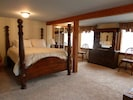Master Bedroom with plush queen bed and master bath