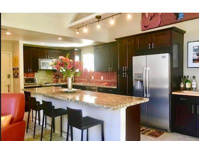 Kitchen 16 foot granite island condo is 1200 sq ft 2bed 3 bth upper unit private